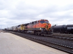 BNSF #1067 and an old Santa Fe SD40-2 head up a westbound CN freight