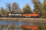 BNSF 9215 Crosses over a pond on the K line.
