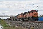 BNSF 9238 leads SB coal train