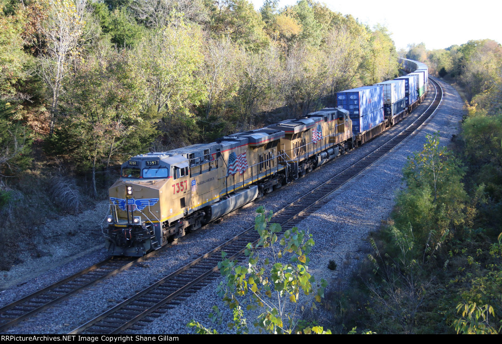 UP 7357 Hustles a westbound stack train.