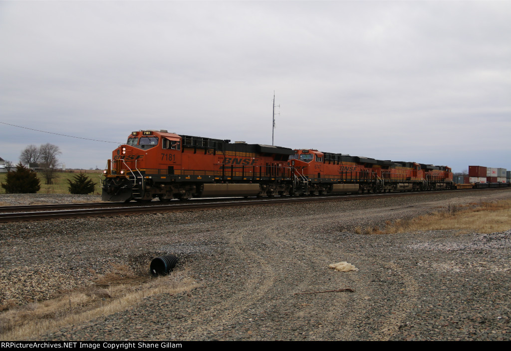 4 GE's rumble a stack train east on the Marceline Sub.