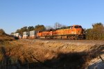 BNSF 4689 Leads a stack train into the morning light.