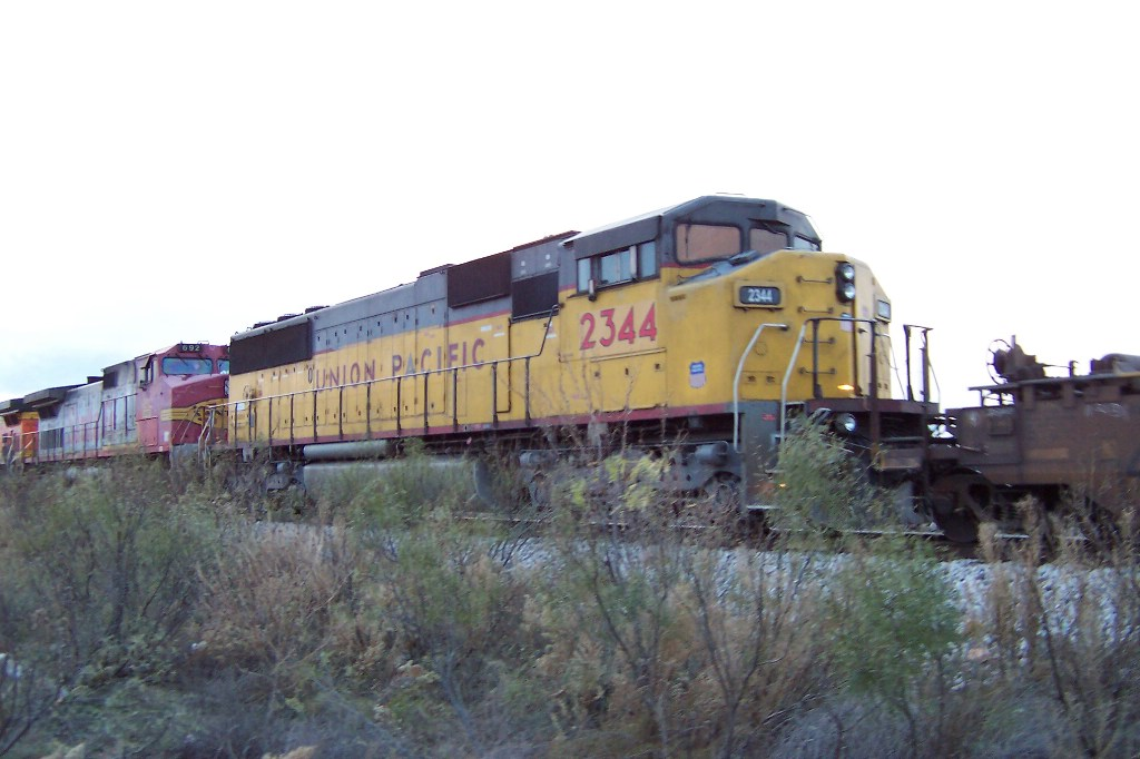 A 3 window SD60 is trailing the BNSF power