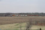 A quartet of BNSF GE's roll a stack train east over the Spoon River bridge