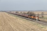 BNSF 7825 leads a long grain train east down the connection to the south end of the yard