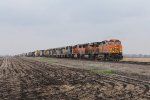 Heading for the yard, BNSF 5084 leads 8 more units including 5 NREX SD40M-2's