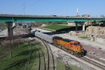 BNSF 4651 slowly rolls north through the Keokuk yard limits with a geometry train