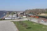 BNSF 6308 leads its coal empties past the old depot and the George M. Verity riverboat