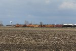 Having both been cleared across the diamonds, a stack train and an empty oil train race west toward Flagg Center