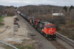 CN 2880 & 3011 slowly roll north with U761 and an oil train to be interchanged to the WSOR for storage