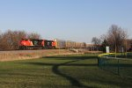 Two newer CN ES44AC's lead a northbound CN oil train with autoracks filling out the headend