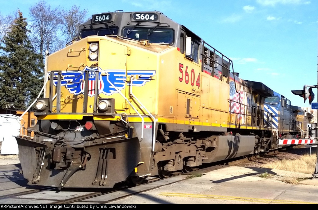 UP 5604, CEFX 1002, and UP 5290 Power A Slow Stacked Freight