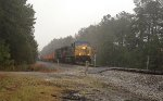 On a rainy March 28, CSX AC44CW 337 and ES40DC 5374