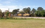 UP SD70ACe 8312 leads C44-9W 9780 and CSX C40-8W 7679 and C40-8 7626