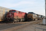 A westbound intermodal arrives to change crew next to the parked tanker train