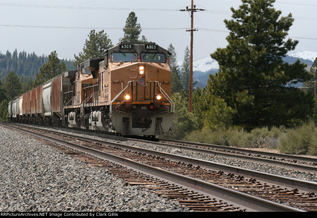 Empty grain train  eastbound getting ready to cross over mainlines
