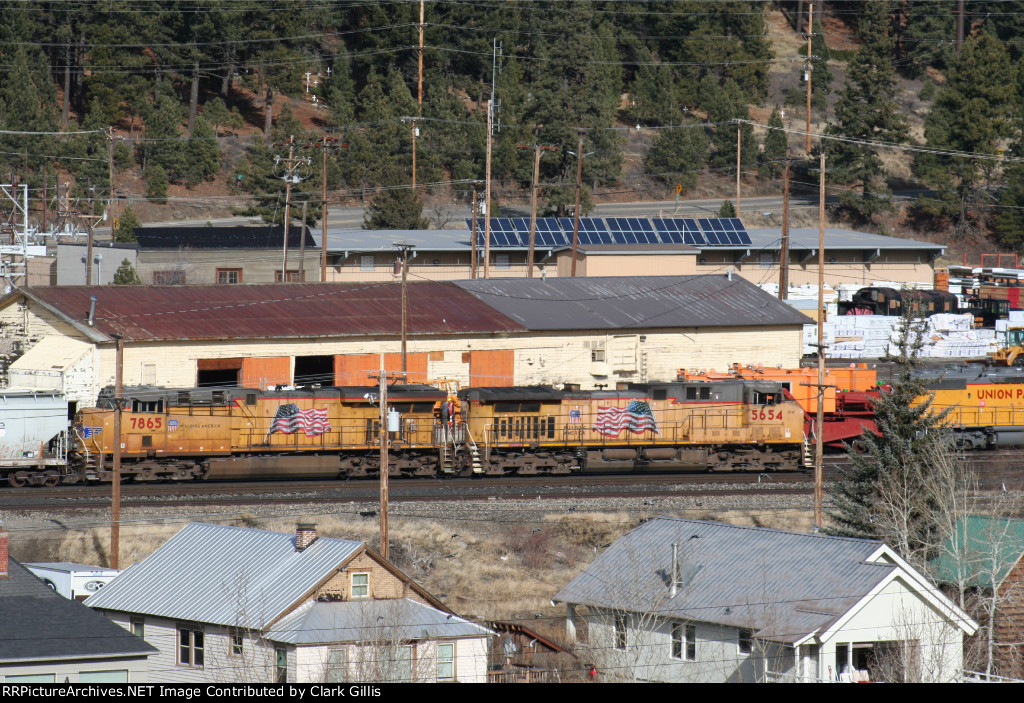 Empty grain train passing through Truckee Yard.