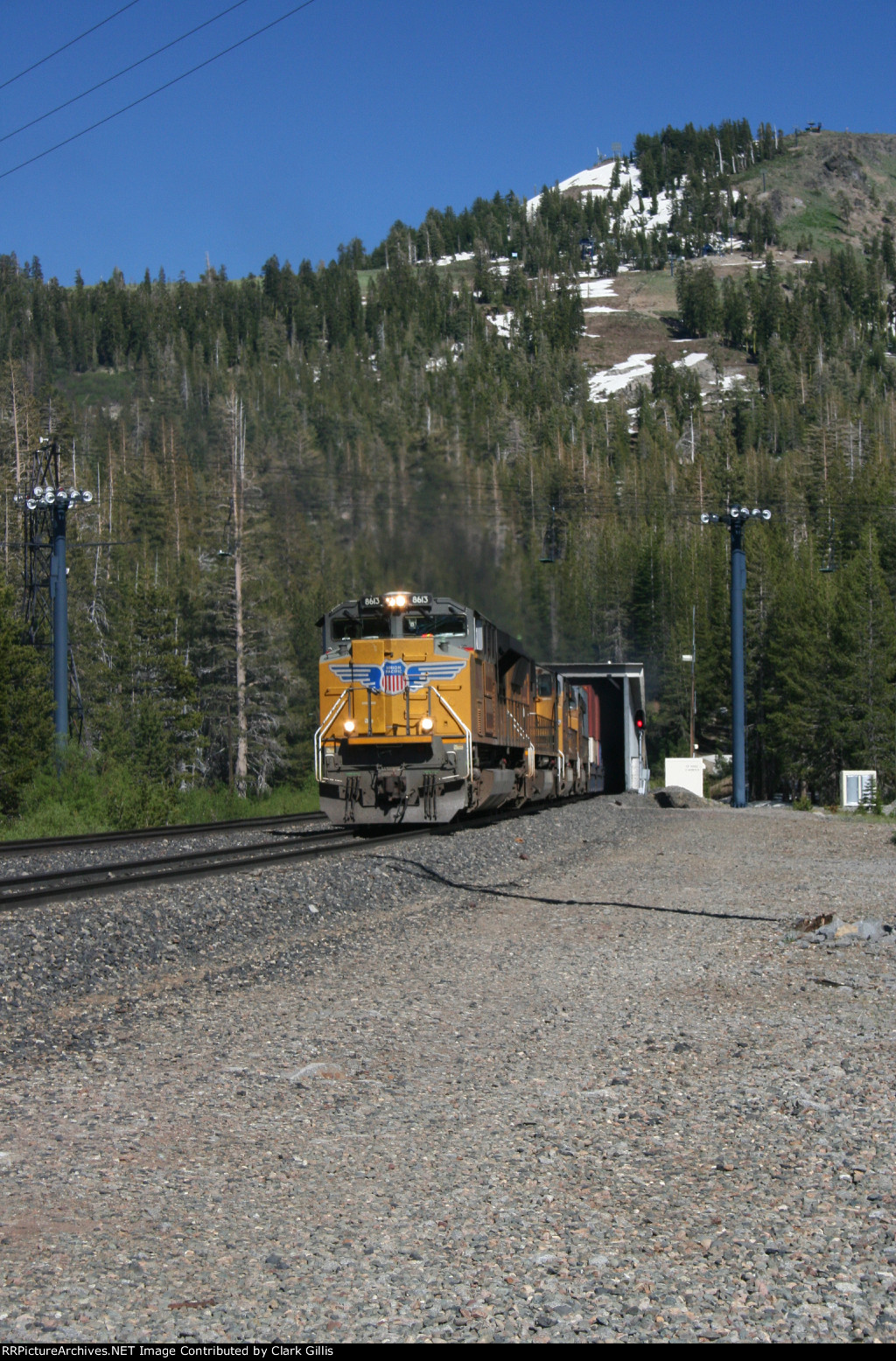 """UP 8613 west coming out of the """"Big Hole"""" (tunnel 41)"""