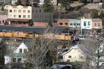 Eastbound empty grain train passing Truckee depot and historic downtown.