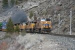 Westbound stac train by Floriston rockslide fencing