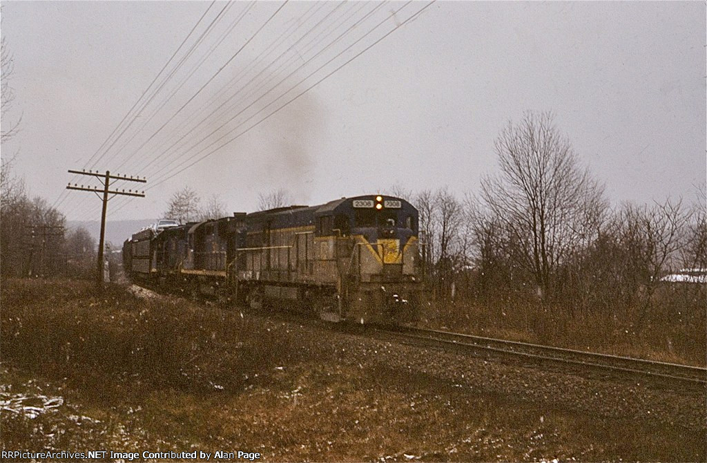 D&H U23B 2306, RS11 5001, and GP38-2 7316