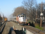 NJT 4137 heads west on track 2 past MOW workers