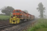 3390, 3406 & 3407 wait to continue north as their train disappears into the fog behind them