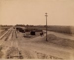 View of a livestock pen adjacent to railroad tracks. Photograph taken at McConnells, near Elk Grove. * Date unknown