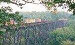 A northbound NS maifest train crosses the James River Bridge.