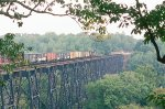 A northbound NS maifest train crosses the James River Bridge.