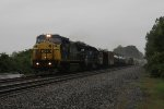 CSX 7359 & HLCX 7181 lead Q501 east across soggy Northern Indiana