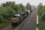CSX 5313 & IC 1037 bring Q368 east on a gloomy, rain soaked morning