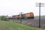 BNSF 4869 heads east on the NS Chicago Line with loaded oil train 66W