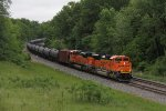 Last in a line of westbounds, a pair of BNSF ACe's lead empty oil train K143