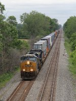 Q146 comes east on 2 with the headlight of the next eastbound in the distance