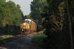 Q254 comes north on the Toledo Sub through one of the last gaps in the late day shadows