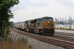 Empty grain train V650-10 rolls north into Kingsport as the Eastman plant looms in the distance