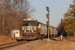 GDLK101 pulls out of the siding at CP14 and past the old NYC signals with a loaded grain train