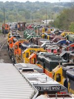 A line of former BNSF SD39's sit as former C&IM SD20 rest in the distance