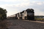 NS 1150 & 7521 roll east out of the evening sun with loaded oil train 66Z