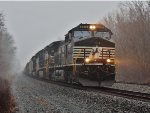 NS 9576 leads eastbound manifest on a dreary misty day