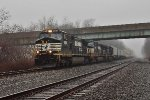 NS 9258 leads westbound pigs and stacks up the old PRR Middle Division