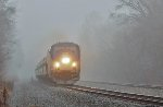The eastbound Pennsylvanian barrels out of the mist at 79MPH