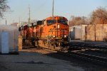 BNSF 7884 Leads a freight into the evening Sun.
