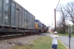 Murphy gets in my way as he videos the train