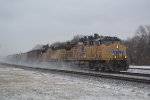 A pair of UP units kick up the snow leading an eastbound oiler.