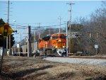 BNSF ES44AC's working hard as they haul a loaded coal train east