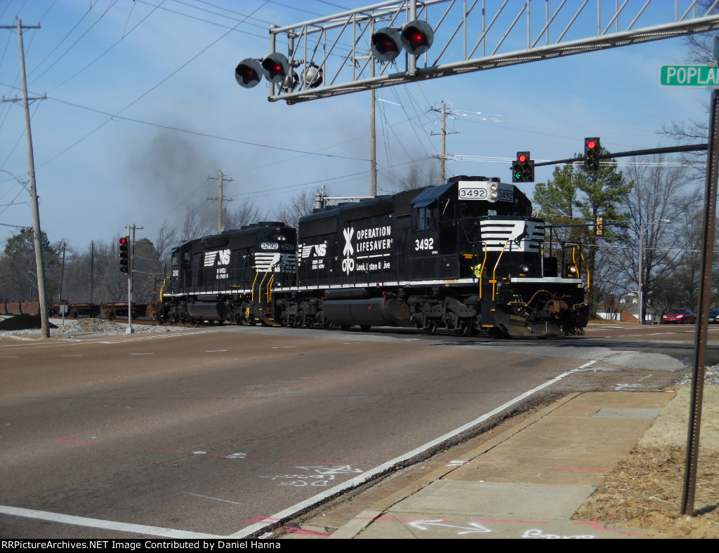 Two NS SD40-2's smoke it up as they come thru the West St crossing.