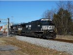 A recently repainted Dash9 leads 22N