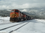 BNSF 5306 C44-9W in front of snowstorm on Gallatin Mountains